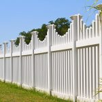 White vinyl fence with contemporary look surrounding a homes backyard