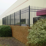 ornamental black fence around patio at a business